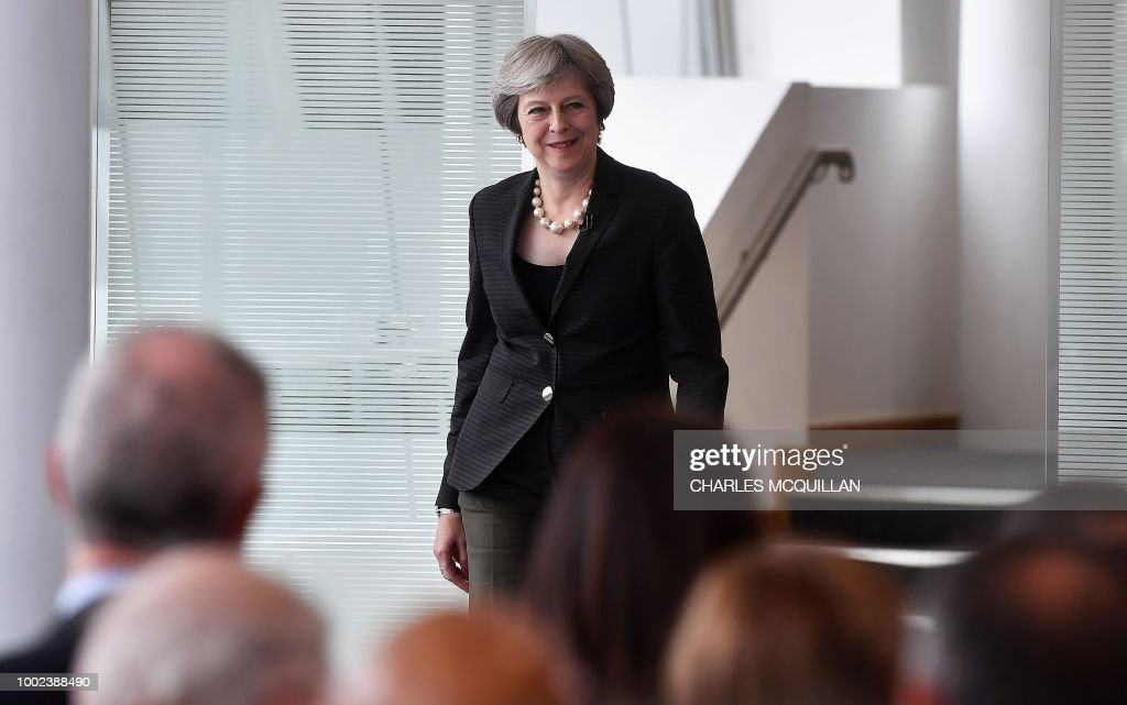 Britain's Prime Minister Theresa May arrives to deliver a keynote speech on Brexit at Waterfront Hall in Belfast, Northern Ireland, on July 20, 2018. - With a trip to Northern Ireland this week, May began a tour of Britain to convince voters to back her blueprint for close economic ties with the bloc after Brexit next March.