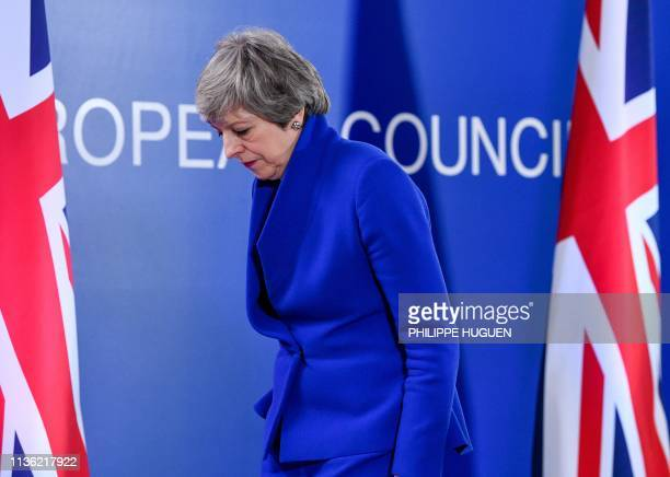 Britain's Prime Minister Theresa May arrives to hold a press conference after the European Council meeting on Brexit at The Europa Building at The...