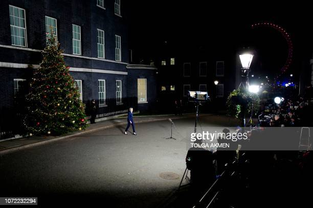 TOPSHOT Britain's Prime Minister Theresa May arrives to make a statement outside 10 Downing Street in central London after winning a confidence vote...