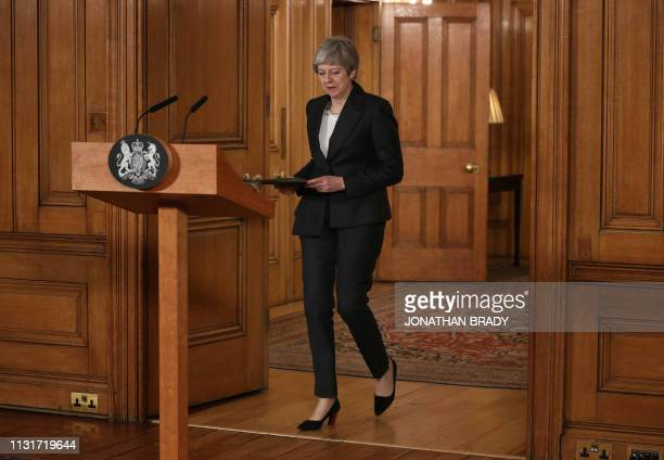 Britain's Prime Minister Theresa May arrives to make a statement inside 10 Downing Street in London on March 20 following her request to EU leaders...