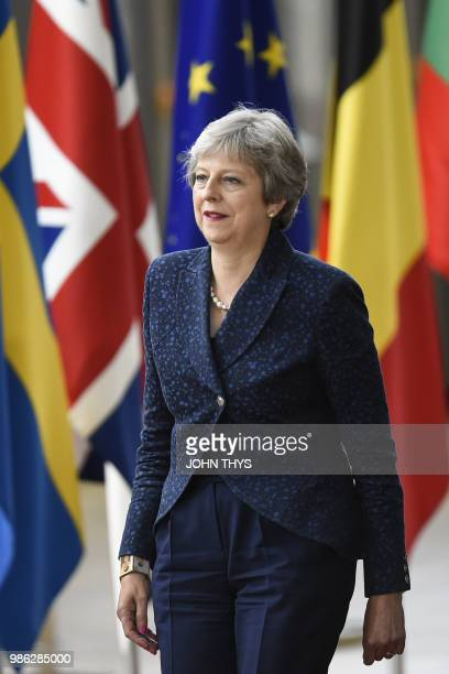 Britain's Prime Minister Theresa May arrives to take part in an European Union leaders' summit focused on migration Brexit and eurozone reforms on...