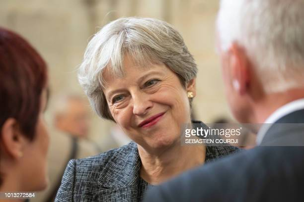 Britain's Prime minister Theresa May attends a religious ceremony to mark the 100th anniversary of the World War I Battle of Amiens at the Cathedral...