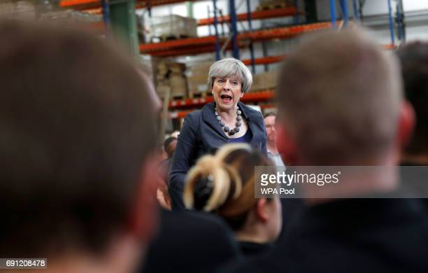 Britain's Prime Minister Theresa May attends an election campaign event at Ultima Furniture on June 1 2017 in Pontefract United Kingdom All parties...