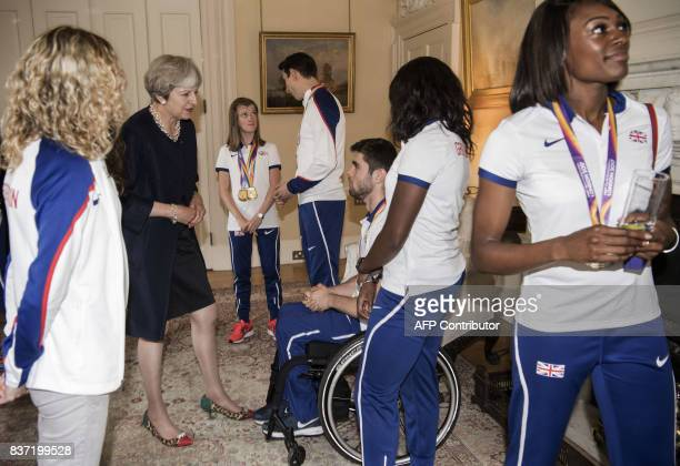 Britain's Prime Minister Theresa May chats to guests during a reception for British athletes who competed in the World Athletics Championships and...