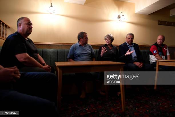 Britain's Prime Minister Theresa May chats to local fishermen on a campaign stop on May 2 2017 in Mevagissey Cornwall England The Prime Minister is...