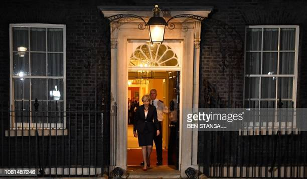 Britain's Prime Minister Theresa May comes out to give a statement outside 10 Downing Street in London on November 14 after holding a cabinet meeting...