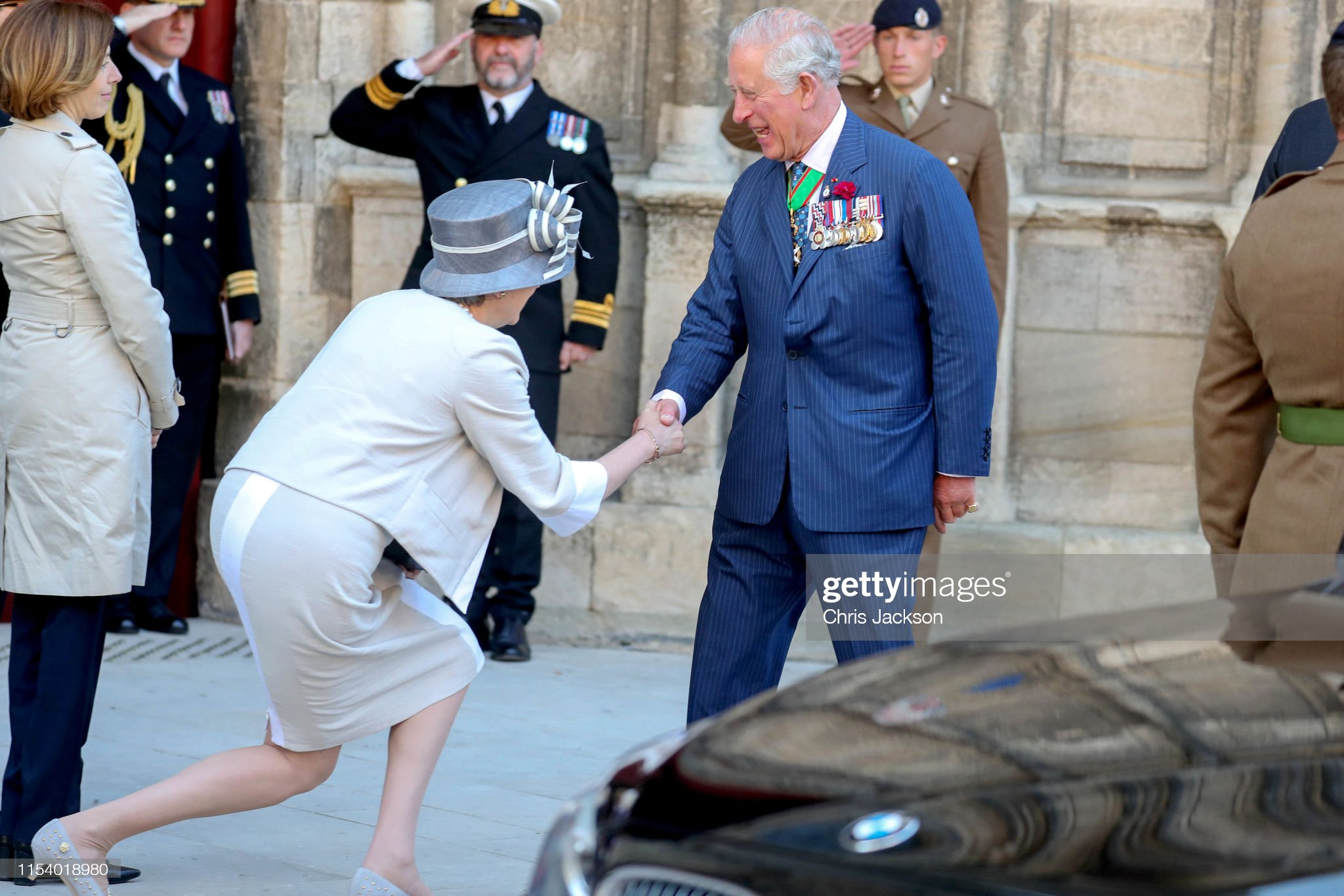 britains-prime-minister-theresa-may-courtesys-for-prince-charles-of-picture-id1154018980