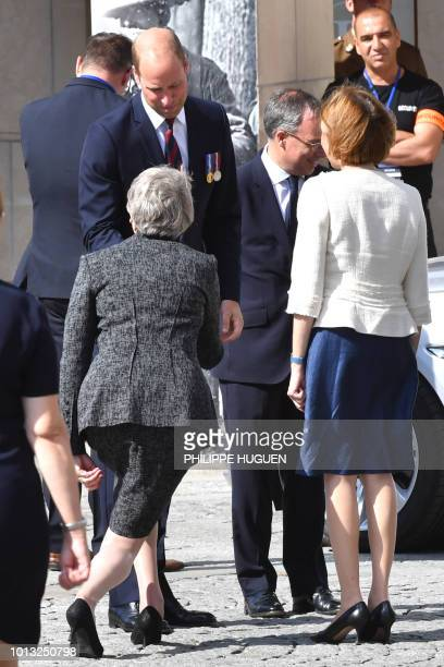 Britain's Prime Minister Theresa May curtsies to Britain's Prince William the Duke of Cambridge as he leave the Cathedral in Amiens following a...