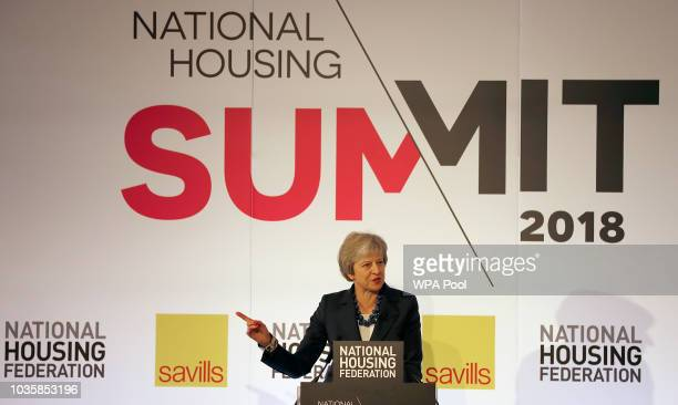 Britain's Prime Minister Theresa May delivers a keynote speech at the National Housing Summit in central London on September 19 2018