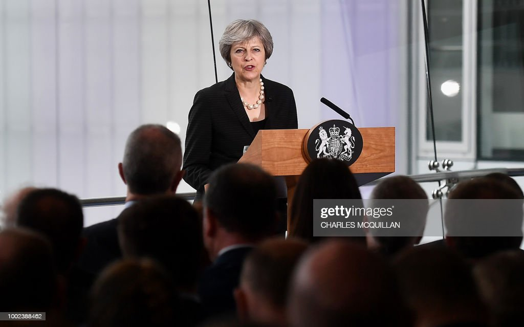 Britain's Prime Minister Theresa May delivers a keynote speech on Brexit at Waterfront Hall in Belfast, Northern Ireland, on July 20, 2018. - With a trip to Northern Ireland this week, May began a tour of Britain to convince voters to back her blueprint for close economic ties with the bloc after Brexit next March.
