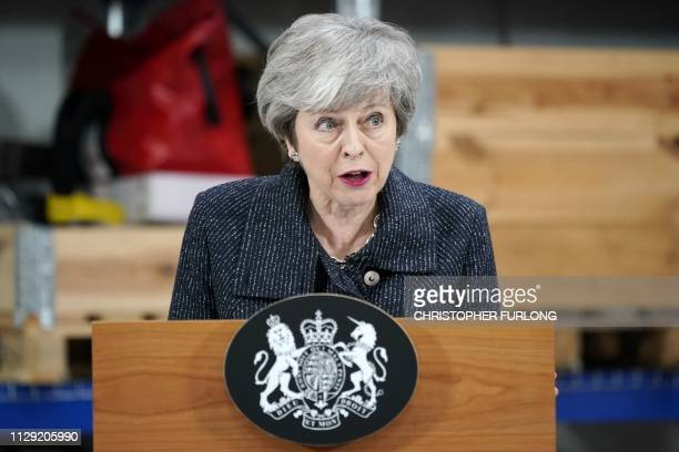 Britain's Prime Minister Theresa May delivers a speech at Orsted East Coast Hub in the North Sea fishing port Grimsby on March 8 2019 Prime Minister...