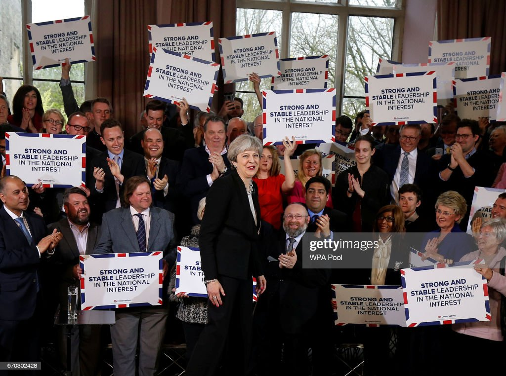 Britain's Prime Minister Theresa May delivers a speech to Conservative Party members to launch their election campaign in Walmsley Parish Hall on April 19, 2017 in Bolton, England. MP's in Parliament have today backed British Prime Minister Theresa May's plan to call a general election for June 8.