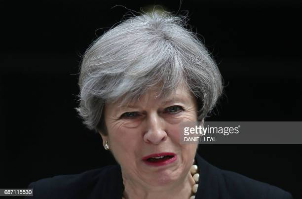 Britain's Prime Minister Theresa May delivers a statement outside 10 Downing Street in central London on May 23 2017 after an emergency meeting of...