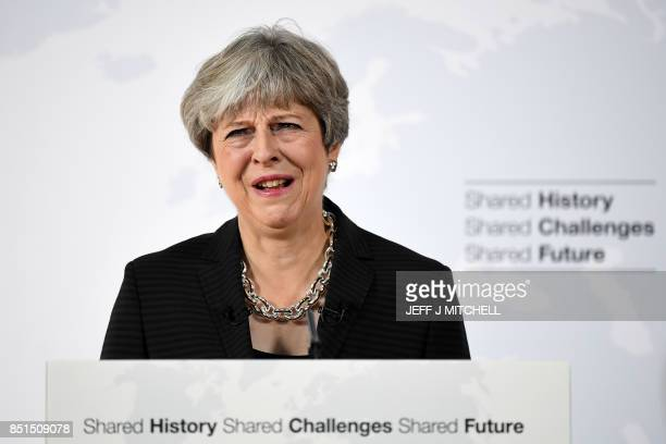 Britain's Prime Minister Theresa May delivers her Brexit speech at the Complesso Santa Maria Novella in Florence, Italy on September 22, 2017. -...