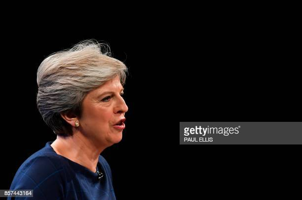 Britain's Prime Minister Theresa May delivers her speech on the final day of the Conservative Party annual conference at the Manchester Central...