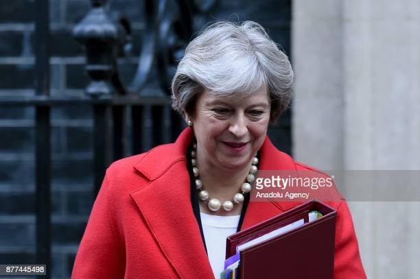 Britain's Prime Minister Theresa May departs downing street before Philip Hammond delivers his budget to Parliament on November 22 2017 in London...