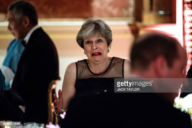 Britain's Prime Minister Theresa May dines in the Picture Gallery at The Queen's Dinner during The Commonwealth Heads of Government Meeting at...
