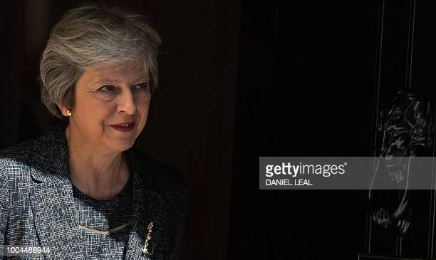 Britain's Prime Minister Theresa May exits 10 Downing Street to greet the Emir of Qatar Sheikh Tamim Bin Hamad alThani in London on July 24 ahead of...