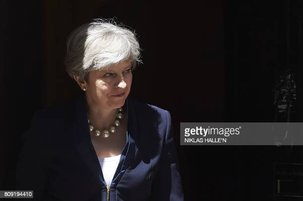Britain's Prime Minister Theresa May exits No 10 Downing St to greet Ukraine Prime Minister Volodymyr Groysman in central London on July 5 2017 / AFP...