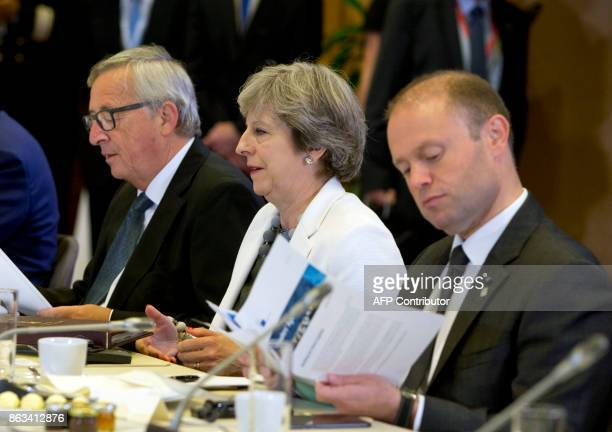 Britain's Prime Minister Theresa May flanked by European Commission President JeanClaude Juncker and Malta's Prime Minister Joseph Muscat attend a...
