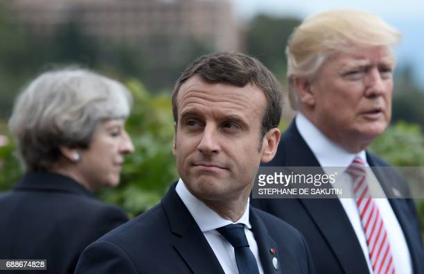 Britain's Prime Minister Theresa May French President Emmanuel Macron and US President Donald Trump attend the Summit of the Heads of State and of...