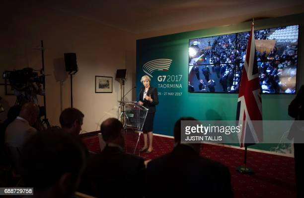 Britain's Prime Minister Theresa May gives a press conference during the Summit of the Heads of State and of Government of the G7, the group of most...