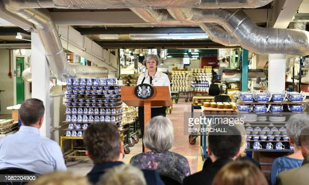 Britain's Prime Minister Theresa May gives a speech at a factory in StokeonTrent to call on MP's to support her Brexit bill on January 14 2019 Prime...