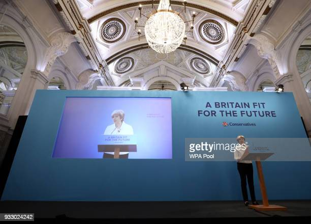Britain's Prime Minister Theresa May gives a speech at the Conservative Party's Spring Forum in central London on March 17 2018 in London England...