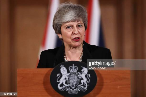 TOPSHOT Britain's Prime Minister Theresa May gives a statement inside 10 Downing Street in London on April 2 2019 after chairing a daylong meeting of...