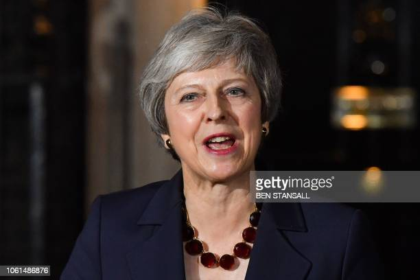 Britain's Prime Minister Theresa May gives a statement outside 10 Downing Street in London on November 14 after holding a cabinet meeting where...