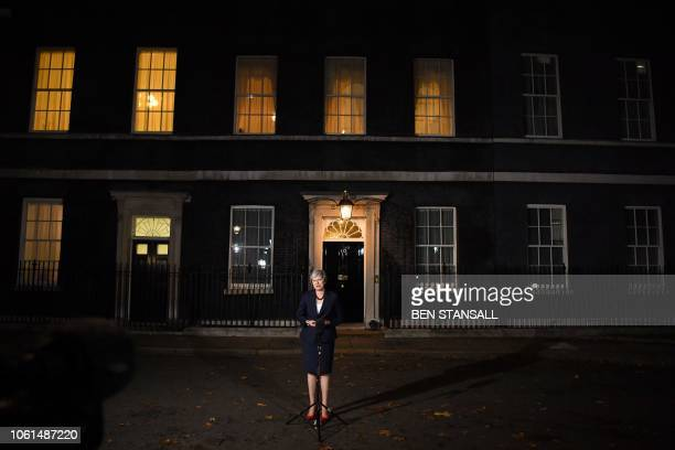 TOPSHOT Britain's Prime Minister Theresa May gives a statement outside 10 Downing Street in London on November 14 after holding a cabinet meeting...