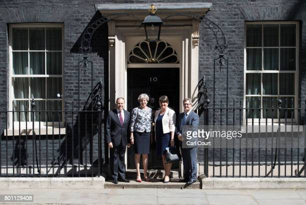 Britain's Prime Minister, Theresa May , greets Arlene Foster, the leader of Northern Ireland's Democratic Unionist Party , deputy leader of the...