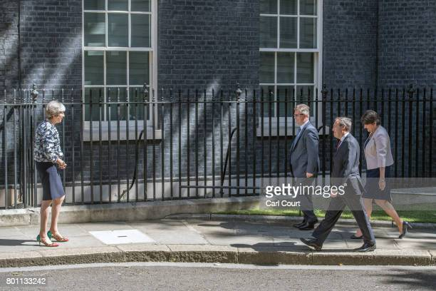 Britain's Prime Minister Theresa May greets Arlene Foster the leader of Northern Ireland's Democratic Unionist Party deputy leader of the Democratic...