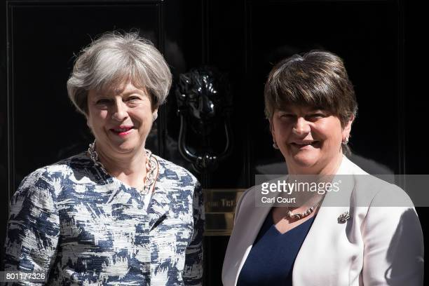 Britain's Prime Minister Theresa May greets Arlene Foster the leader of Northern Ireland's Democratic Unionist Party in Downing Street on June 26...