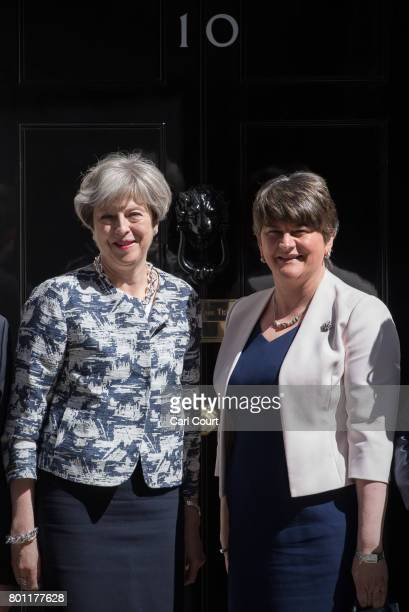 Britain's Prime Minister Theresa May greets Arlene Foster the leader of Northern IrelandÕs Democratic Unionist Party in Downing Street on June 26...