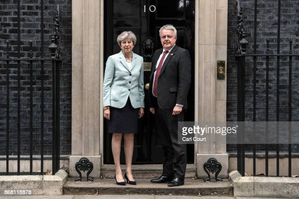 Britain's Prime Minister Theresa May greets Carwyn Jones the First Minister of Wales as he arrives in Downing Street on October 30 2017 in London...