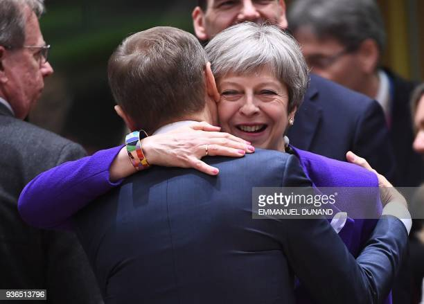 Britain's Prime minister Theresa May greets European Council President Donald Tusk as they attend a European leaders summit at the European Council...