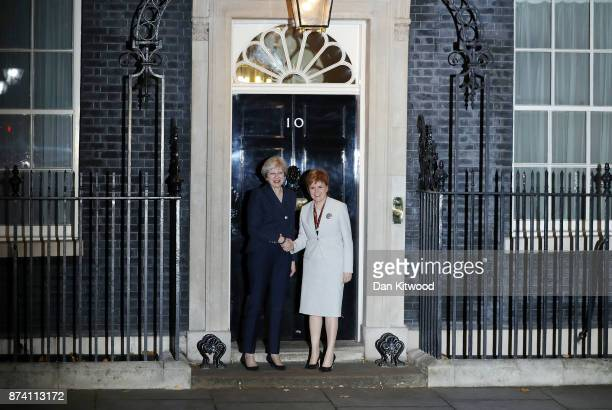 Britain's Prime Minister Theresa May greets First Minister and Scottish National Party Leader Nicola Sturgeon to 10 Downing Street on November 14...