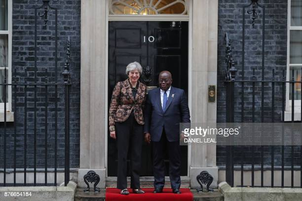 Britain's Prime Minister Theresa May greets Ghana's President Nana AkufoAddo outside 10 Downing Street in central London on November 20 2017 / AFP...