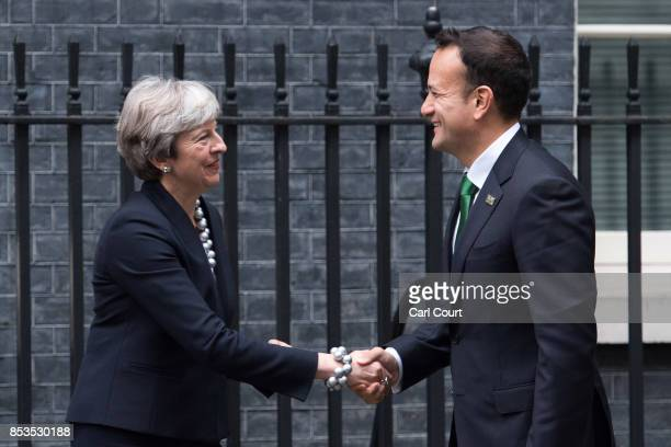 Britain's Prime Minister Theresa May greets Ireland's Taoiseach Leo Varadkar as he arrives in Downing Street on September 25 2017 in London England...