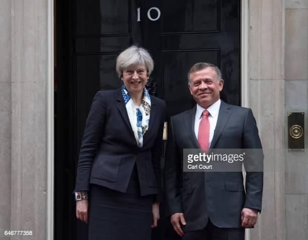 Britain's Prime Minister Theresa May greets King Abdullah II of Jordan as he arrives in Downing Street on March 1 2017 in London England Mrs May and...