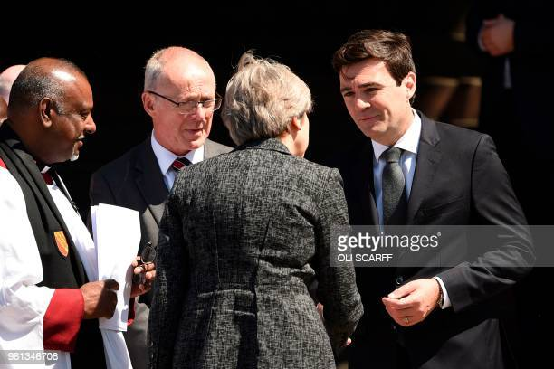 Britain's Prime Minister Theresa May greets Mayor of Greater Manchester Andy Burnham as she arrives to attend The Manchester Arena National Service...