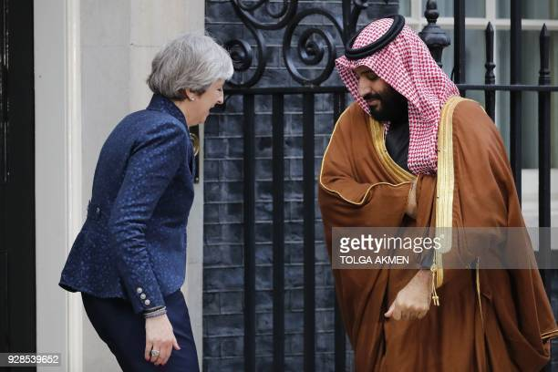 TOPSHOT Britain's Prime Minister Theresa May greets Saudi Arabia's Crown Prince Mohammed bin Salman outside 10 Downing Street in central London on...