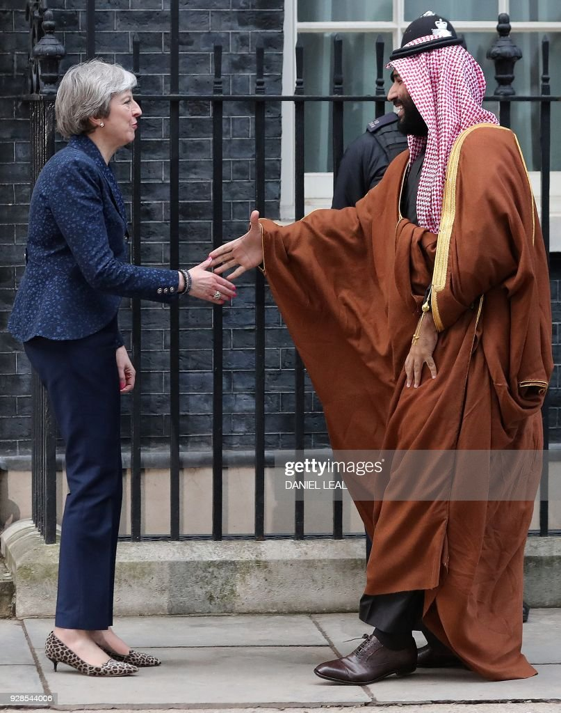 Britain's Prime Minister Theresa May (L) greets Saudi Arabia's Crown Prince Mohammed bin Salman (R) outside 10 Downing Street, in central London on March 7, 2018. British Prime Minister Theresa May will 'raise deep concerns at the humanitarian situation' in war-torn Yemen with Saudi Crown Prince Mohammed bin Salman during his visit to Britain beginning Wednesday, according to her spokesman. / AFP PHOTO / Daniel LEAL