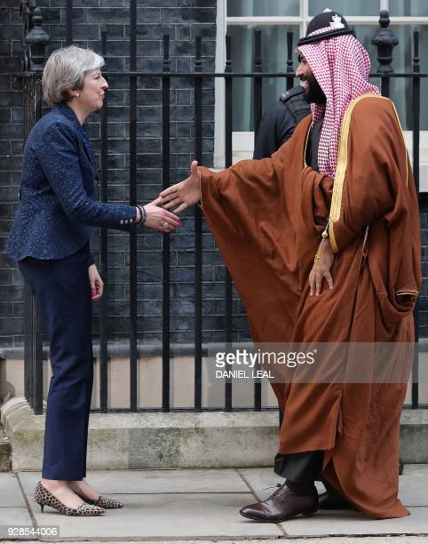 Britain's Prime Minister Theresa May greets Saudi Arabia's Crown Prince Mohammed bin Salman outside 10 Downing Street in central London on March 7...