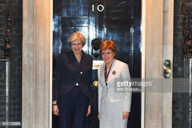 Britain's Prime Minister Theresa May greets Scotland's First Minister Nicola Sturgeon at 10 Downing Street in central London on November 14 2017 /...