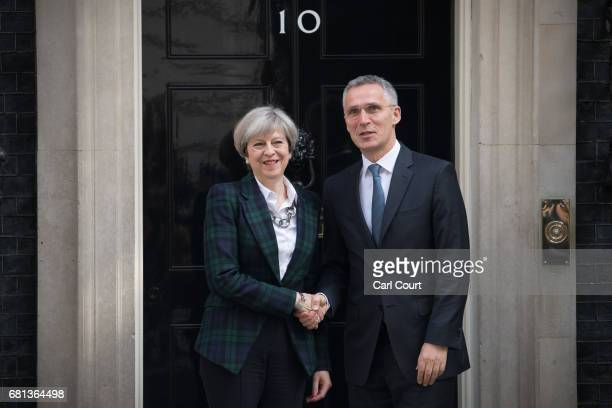 Britain's Prime Minister Theresa May greets Secretary General of NATO Jens Stoltenberg upon his arrival in Downing Street on May 10 2017 in London...
