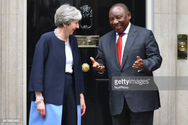 Britain's Prime Minister Theresa May greets South Africa's President Cyril Ramaphosa at 10 Downing Street in central London, prior to bilateral talks...