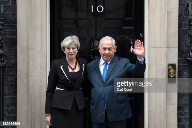 Britain's Prime Minister Theresa May greets the Prime Minister of Israel Benjamin Netanyahu in Downing Street on November 2 2017 in London England...