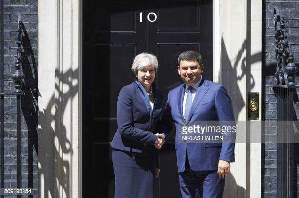 Britain's Prime Minister Theresa May greets Ukraine Prime Minister Volodymyr Groysman outside No 10 Downing St in central London on July 5 2017 / AFP...